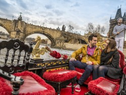 Loving couple on a Venetian gondola on the Vltava | Gondolier