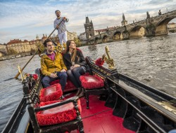 Loving couple on original Venetian gondola near Charles Bridge | gondolier